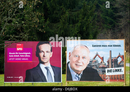 Election posters campaigning for the Saarland state elections show the top candidates Heiko Maas (Social Democrats - Stock Photo