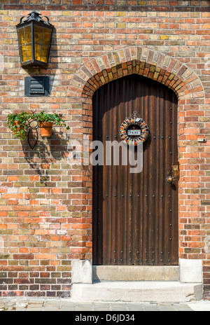 Beautiful door with sign reads 'Private' on Dutch - Stock Photo