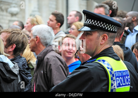 Crowds and London Transport Police officer at Margaret Thatcher's funeral at St Paul's Cathedral - April 17th 2013 - Stock Photo