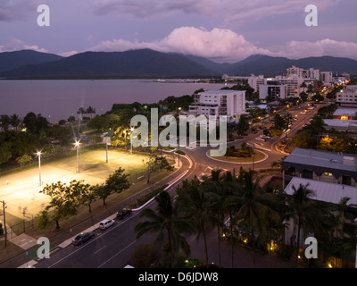 Waterfront and view towards city centre at dusk from south, Cairns, North Queensland, Australia, Pacific - Stock Photo