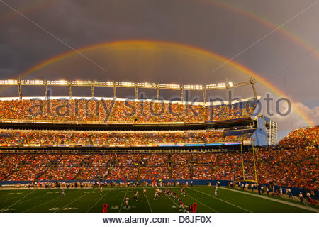 A rainbow over Sports Authority Field at Mile High (stadium), Denver, Colorado USA - Stock Photo
