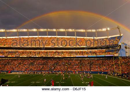 A rainbow over Sports Authority Field at Mile High (stadium), Denver, Colorado USA - Stock Photo