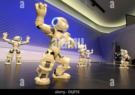 Robots of the 'NAORobot Show' dance at Phaeno Science Center in Wolfsburg,Germany, 16 March 2012. A robot festival - Stock Photo