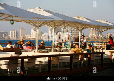 People sitting at Casita Bar and Restaurant in Old Jaffa with a view over the sea and Tel Aviv, Israel, Middle East - Stock Photo