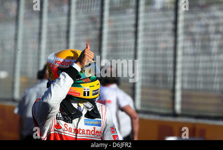 British Formula One driver Lewis Hamilton of McLaren Mercedes reacts after he clocked the fastest time in the Qualifying - Stock Photo