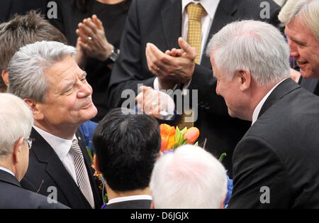 New German President Joachim Gauck (L) accepts flowers and congratulations from Premier of Bavaria Horst Seehofer - Stock Photo