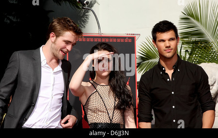 Robert Pattinson, Kristen Stewart , Taylor Lautner Stars of 'The Twilight Saga' films are honoured with a Hand and - Stock Photo