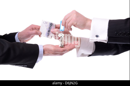 two men exchanging keys for money isolated on white background - Stock Photo