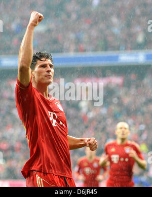 Munich's Mario Gomez cheers after his 2-0 goal during the Bundesliga soccer match between FC Bayern Munich and Hanover - Stock Photo