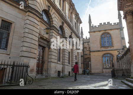 Wandering past the Sheldonian Theatre towards the Bodleian Library, Oxford, Oxfordshire, England, United Kingdom, - Stock Photo