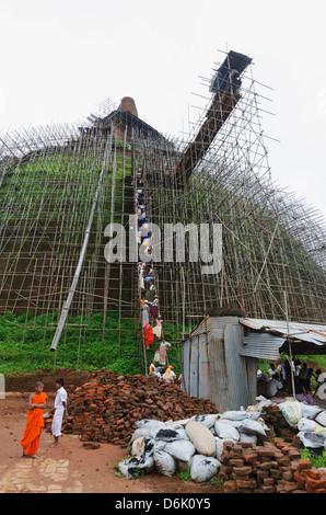 Workers and scaffolding on the Abhayagiri Dagoba, Anuradhapura, UNESCO World Heritage Site, Sri Lanka, Asia - Stock Photo