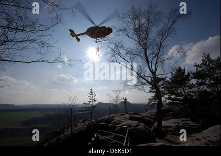 Rescue forces aboard helicopter 'Christoph 62' during a joint mountain rescue service manoeuvre of German automobile - Stock Photo