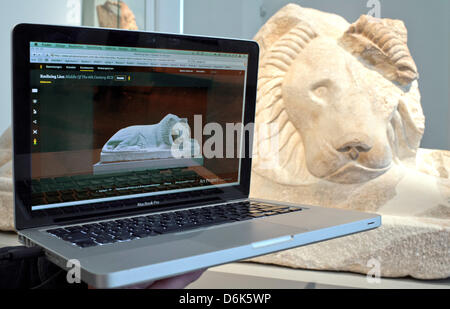 The Greek statue of a resting lion from the sixth century BC is seen on a monitor showing the google website googleartproject.com - Stock Photo