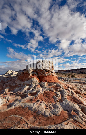Red and white sandstone formations under clouds, White Pocket, Vermillion Cliffs National Monument, Arizona, USA - Stock Photo