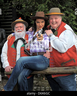 The Wildecker Herzbuben Wilfired Gliem (L) and Wolfgang Schwalm (R) pose with Henriette Ehrlich as Cat Ballou (C) - Stock Photo