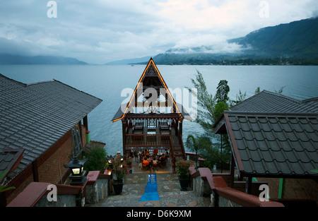 Evening view across Lake Toba from Batak Toba style hotel on Samosir Island, Lake Toba, Sumatra, Indonesia, Southeast Asia, Asia
