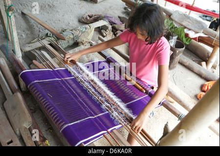 Batak tribeswoman weaving sarong with Batak Toba design, Buhit, Samosir Island, Lake Toba, Sumatra, Indonesia, Southeast - Stock Photo