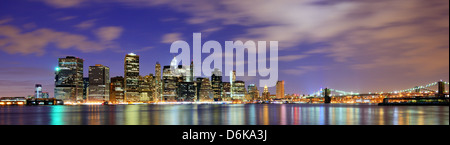 Lower Manhattan from across the East River in New York City. - Stock Photo