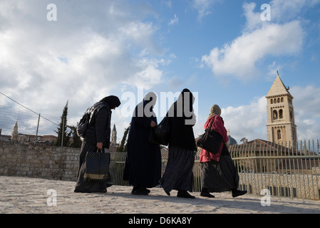 Four Russian female pilgrims on a terrace with Redeemer church and Holy Sepulcher in background. Jerusalem Old City. - Stock Photo