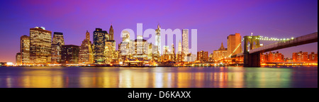 New York City panorama with the Brooklyn Bridge and the Financial district from across the East River. - Stock Photo