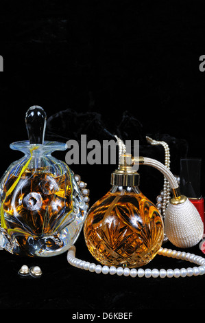 Perfume atomiser bottle, Perfume bottle with stopper and jewellery. - Stock Photo