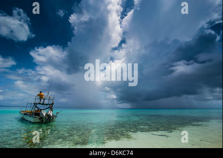Little motor boat in the turquoise waters of the Ant Atoll, Pohnpei, Micronesia, Pacific - Stock Photo