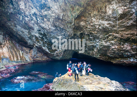 Divers preparing for dive in the grotto collapsed cave on Saipan, Northern Marianas, Central Pacific, Pacific - Stock Photo