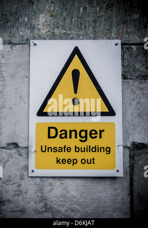 Danger Unsafe Building sign - Keep Out - Stock Photo