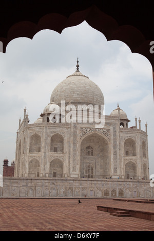 Taj Mahal framed by arch seen from the Jawab (east side) - Stock Photo
