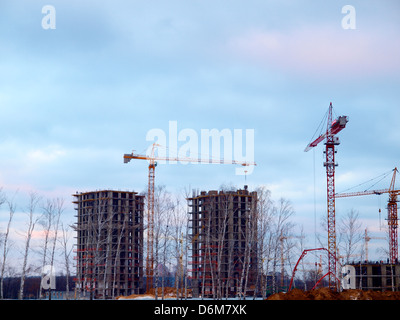 Construction of new residential buildings by pouring concrete - Stock Photo