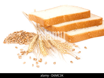 Wheat grains, ears and bread on white bcakground - Stock Photo