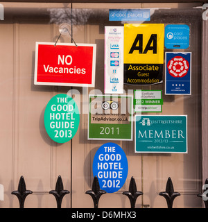 Signs in the window of a bed and breakfast in Salisbury , Wiltshire , England , Britain , Uk - Stock Photo