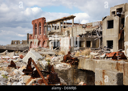 Ruins on the abandoned island of Gunkanjima off the coast of Nagasaki Prefecture, Japan. - Stock Photo