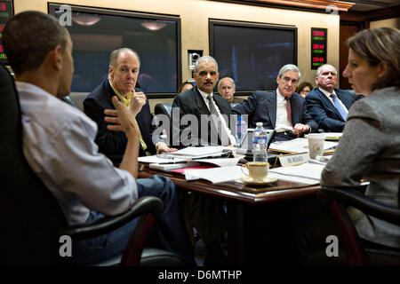 US President Barack Obama holds a meeting in Situation Room on the ongoing investigation in the Boston Marathon - Stock Photo