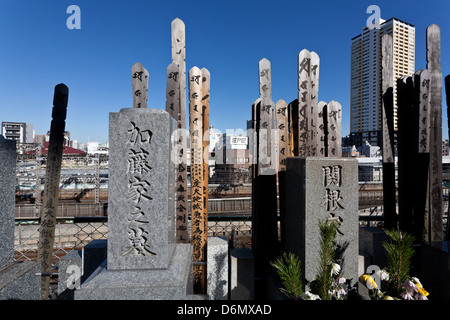 Toba wooden tablets and graves headstones in Yanaka cemetery, Nippori, Tokyo, Japan. Friday January 11th 2013 - Stock Photo