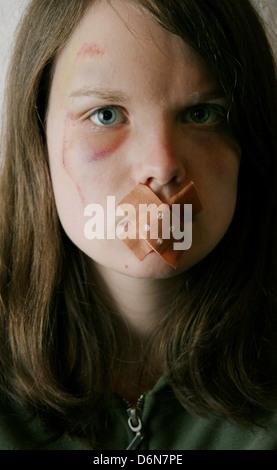 teenager,fear,adhesive bandage,violence,mute - Stock Photo
