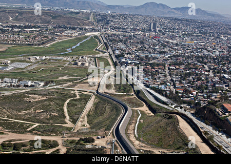 Aerial view of the border fence separating San Diego and Tijuana February 17, 2012 in San Diego, CA - Stock Photo
