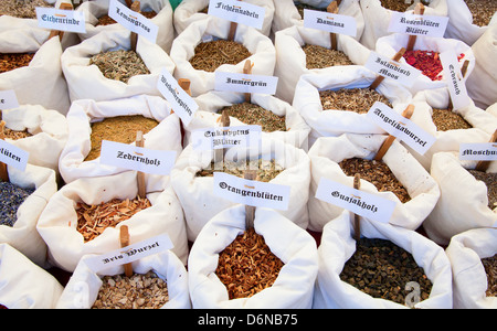 Various spices on the market - Stock Photo