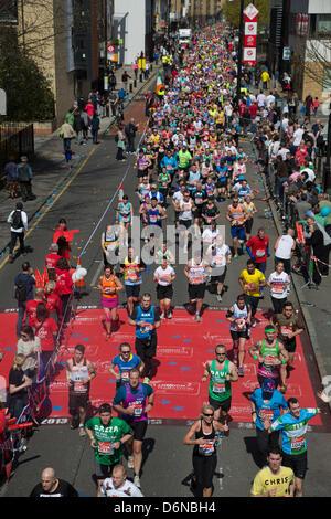 London, UK, 21 April 2013. London Marathon runners stream down Westferry Road on the Isle of Dogs. Credit: Sarah - Stock Photo