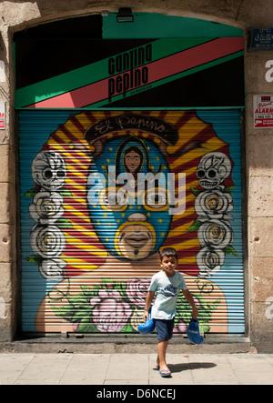 Child shadow boxing on Las Ramblas, Barcelona, Spain, Europe - Stock Photo