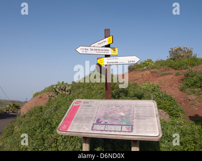 Signpost with directions for hikers and Information board about the rural park of Teno Alto in Tenerife Spain. - Stock Photo