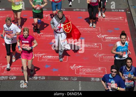 London, UK, 21 April 2013. A runner dressed as an English knight runs the Virgin London Marathon. Credit: Sarah - Stock Photo
