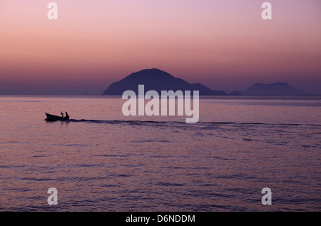 Alicudi, Italy, overlooking the islands Filicudi (left) and Salina at dusk - Stock Photo