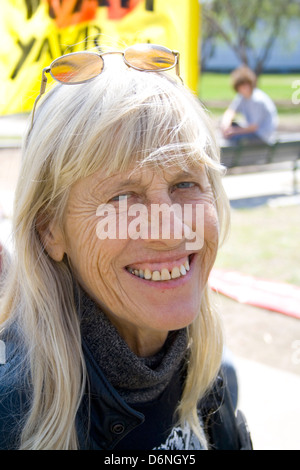 Blond haired happy mature woman with protruding teeth smiling. MayDay Parade and Festival Minneapolis Minnesota - Stock Photo