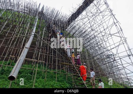Workers and scaffolding on the The Abhayagiri Dagoba, Anuradhapura, UNESCO World Heritage Site, Sri Lanka, Asia - Stock Photo