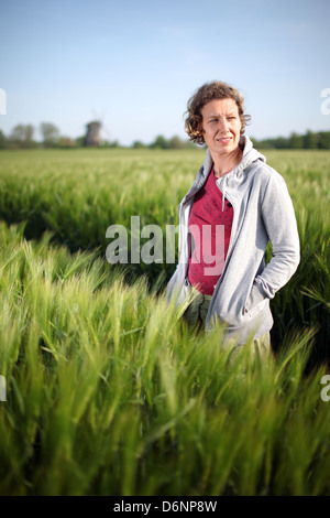 Wangels, Germany, a woman on grain field - Stock Photo