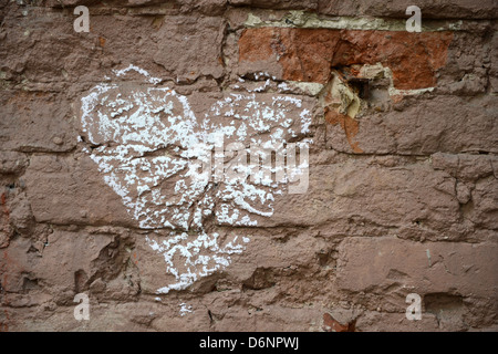 Berlin, Germany, from a painted circle heart on a wall in a backyard - Stock Photo