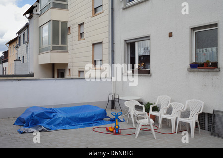Pirmasens, Germany, plastic chairs in front of a house in Pirmasens - Stock Photo