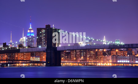Brooklyn Bridge and famed skyscrapers in New York City - Stock Photo