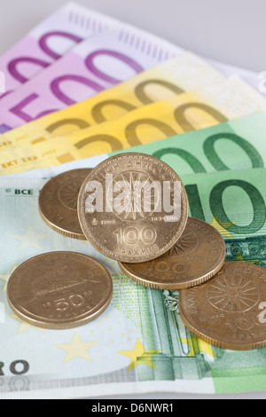 Berlin, Germany, Euro notes and former Greek drachma coins - Stock Photo